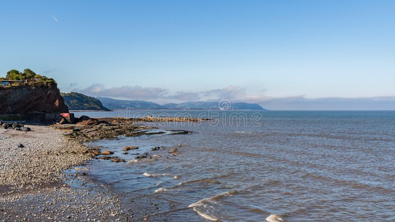 Watchet, England, UK. The beach in Watchet, Somerset, England, UK - with Minehead in the background royalty free stock photo