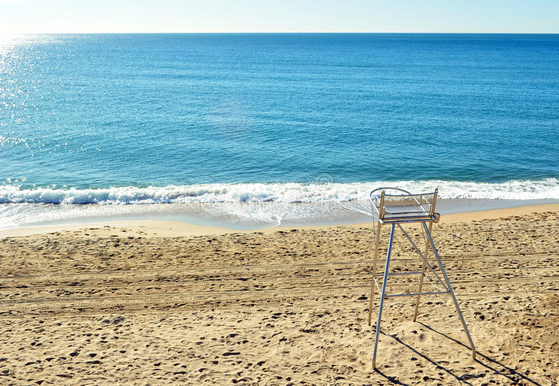 Watchful beach chair in lonely morning royalty free stock photography