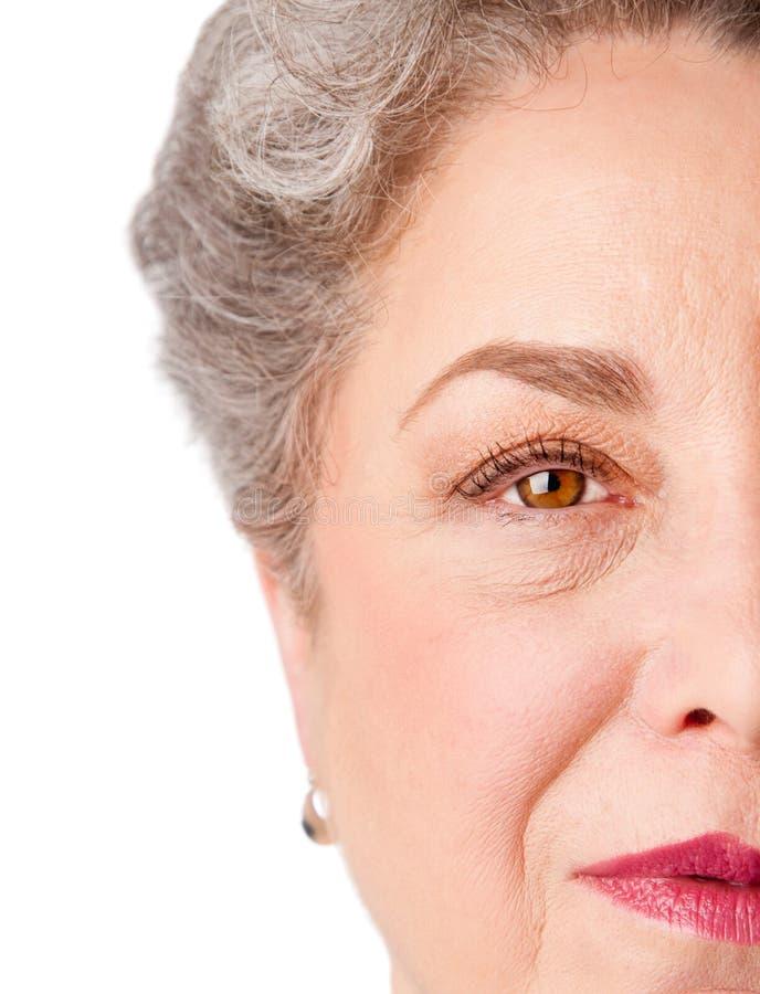 watchful erfarenhetsögonpensionär arkivfoto