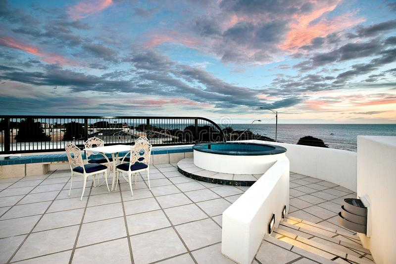 Watching the clouds roll in from your private jacuzzi on the roof !! stock photos