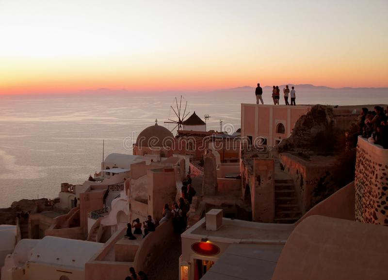 Watching the Famous Oia Sunset at Oia Village on Santorini Island of Greece stock images