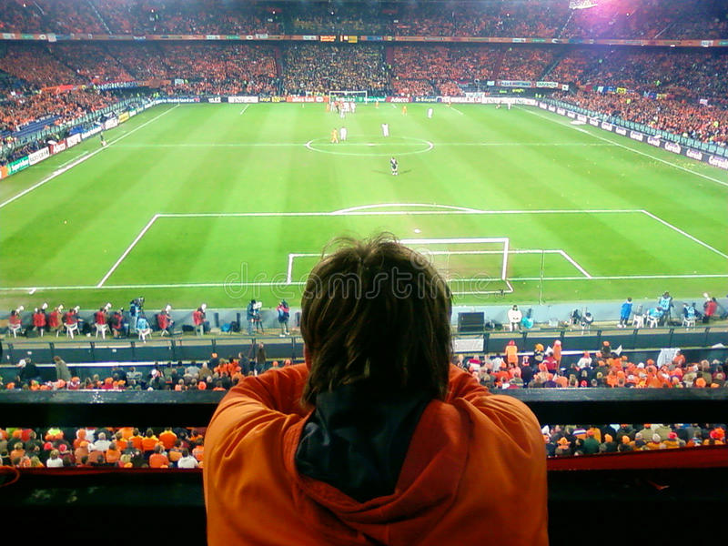 Download Watching a football game editorial stock image. Image of orange - 27550564