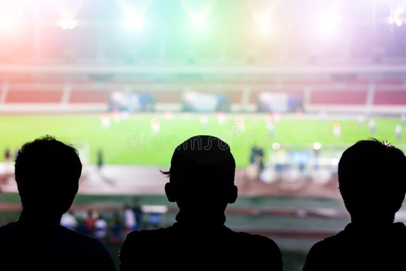Watching football game. Three men watching football game stock image