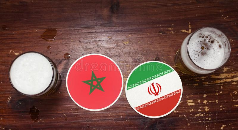 World Cup 2018 Match Calendar, Beer Mats Concept Flyer Background. Watching football together concept. Coasters at the bar with flags and symbols of Morocco and stock photography