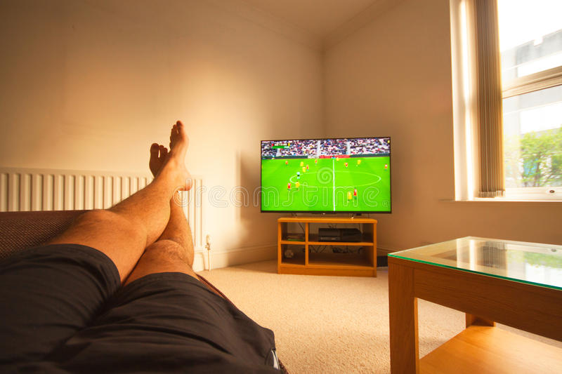 Watching Football on TV stock photography