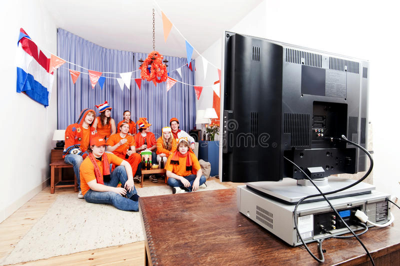Watching the game at home stock photography