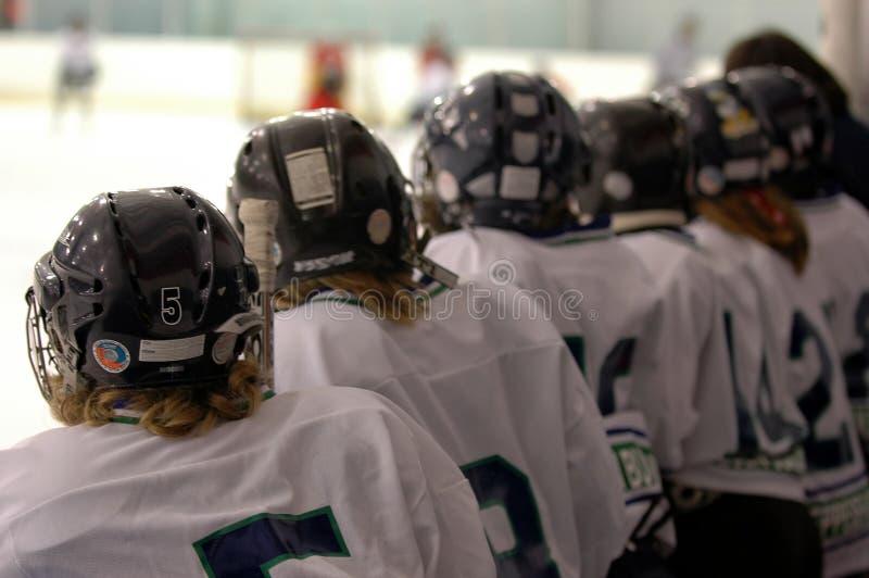 Watching the hockey game stock image