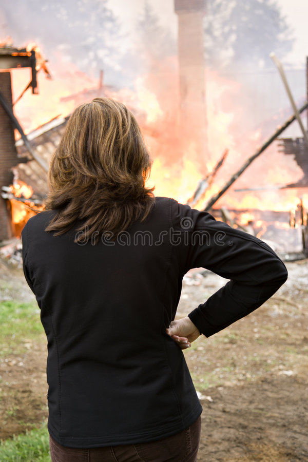 Watching the house burn down stock image