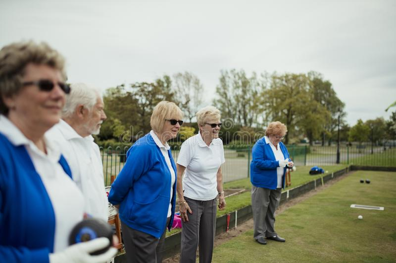 Watching the Lawn Bowling Game royalty free stock photography