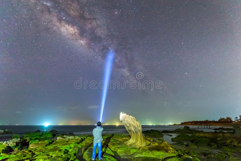 Watching Milky Way with ancient stone fossil stock photography