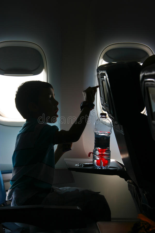 Watching a movie in the airplane stock images