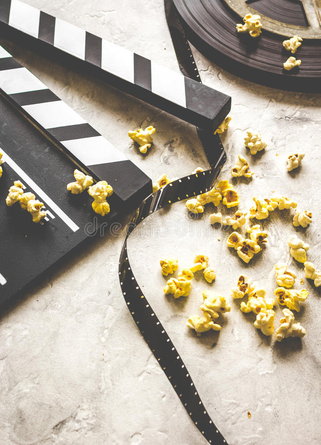 Watching movie with popcorn on gray background close up.  stock photos