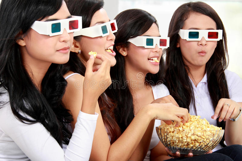 Watching movie wearing 3d glasses royalty free stock photography
