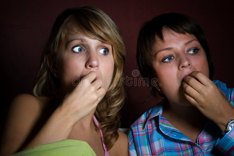 Watching a scary movie stock images