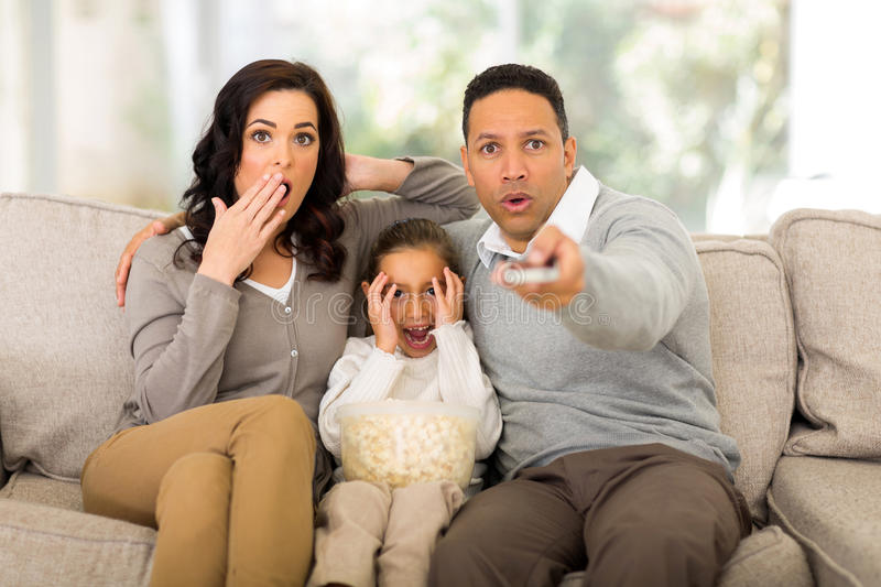 Watching scary movie stock photography