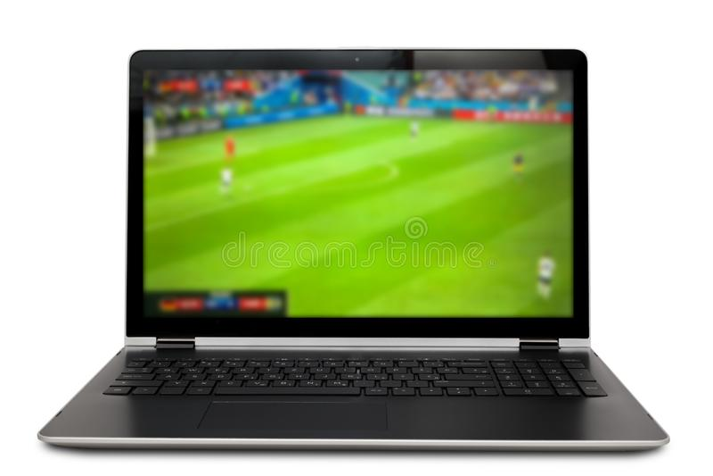 Watching soccer game on laptop. Screen royalty free stock image