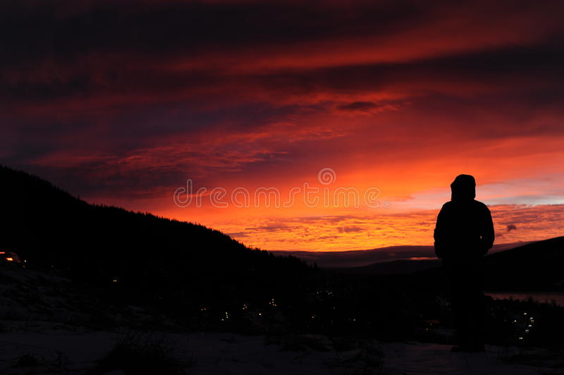 Watching sunrise in the mountains in northern Sweden stock images