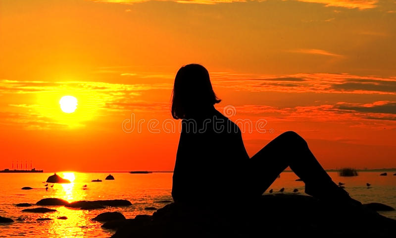 Watching the sunset royalty free stock images