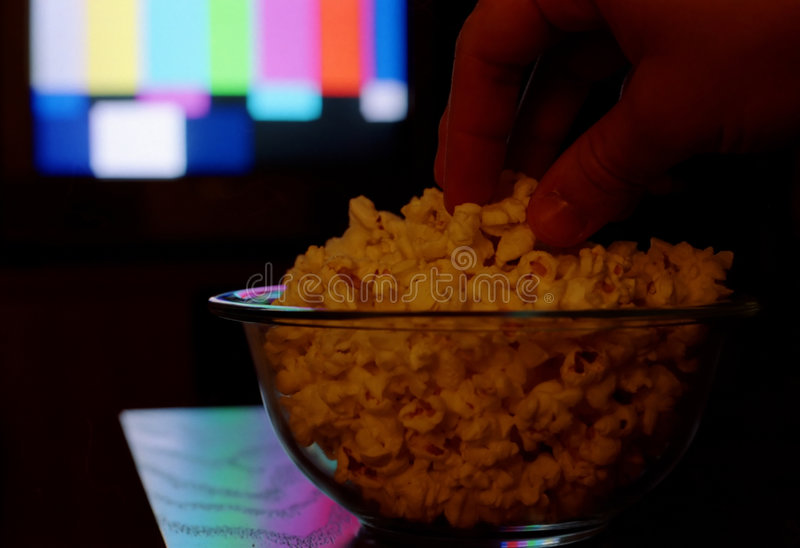 Watching television. stock images