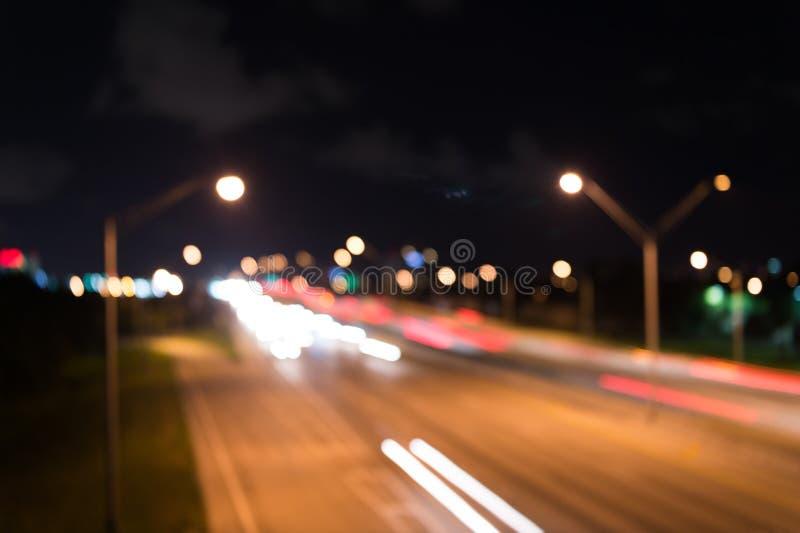 Watching transport moving in street. Urban traffic. Blurred car lights night. Urban night. Lights defocused background. Night city lights. Illumination and royalty free stock images