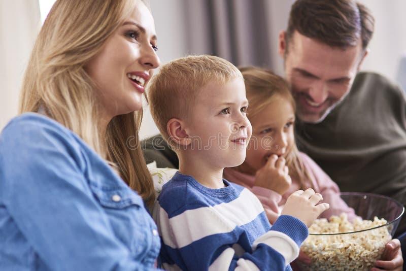 Watching tv at home royalty free stock image