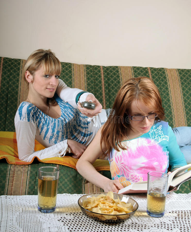 Watching TV And Reading Book Royalty Free Stock Photos