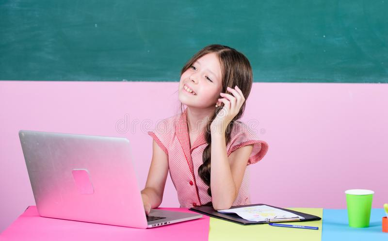 Watching video lessons. Online school. Online schooling. Distant education. Pupil study digital technology. Educative stock images