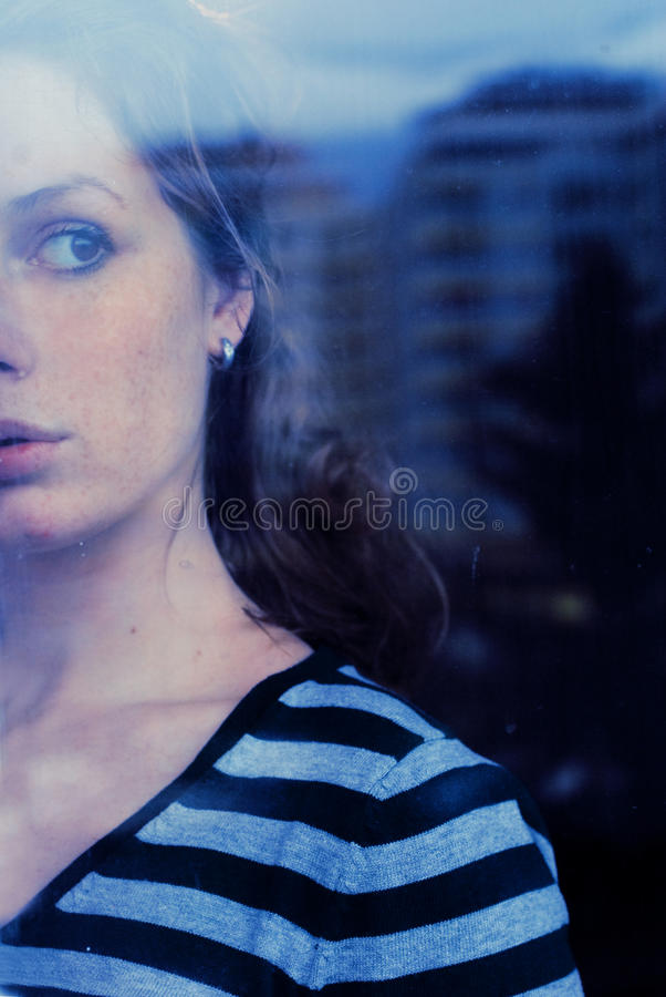 Watching young woman royalty free stock photography