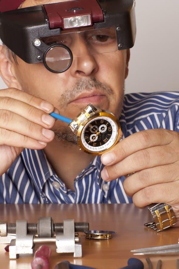 Watchmaker. Watch repair craftsman repairing watch. Focus on watch stock photography