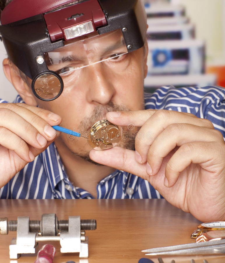 Watchmaker. Watch repair craftsman repairing watch. Focus on watch stock images