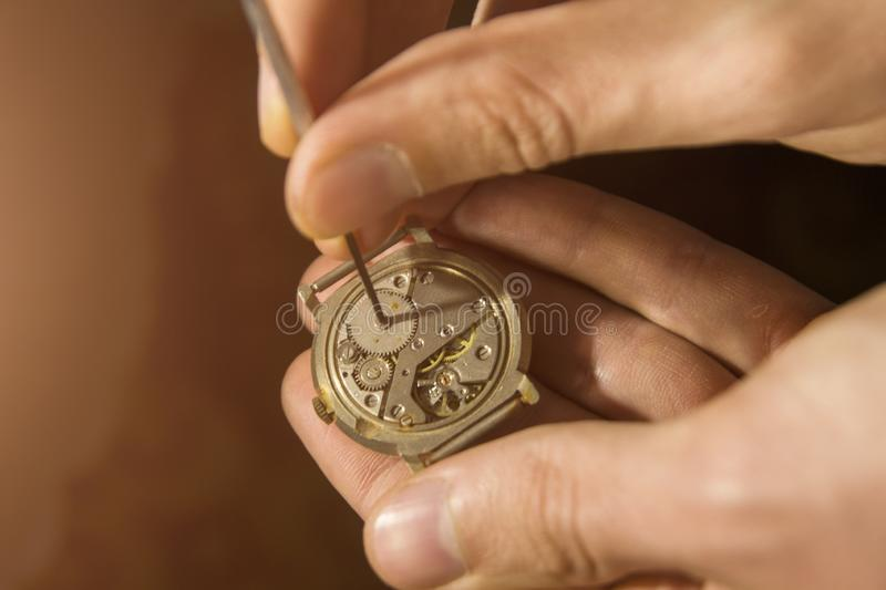 Watchmaker is repairing the mechanical watches in his workshop royalty free stock photo