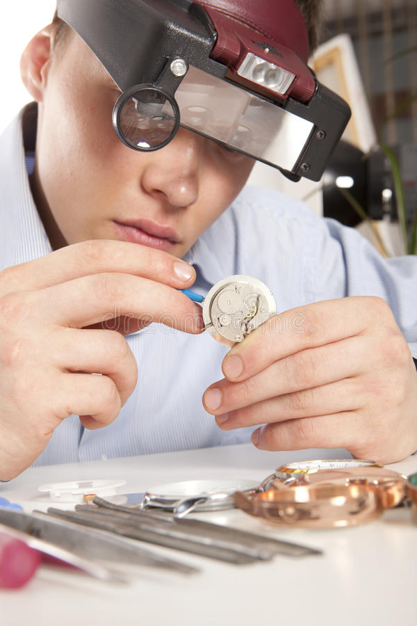 Watchmaker. Watch repair craftsman repairing watch stock photos