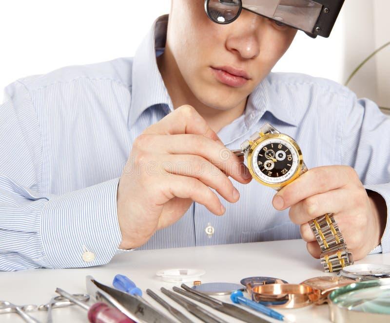 Watchmaker. Watch repair craftsman repairing watch royalty free stock image