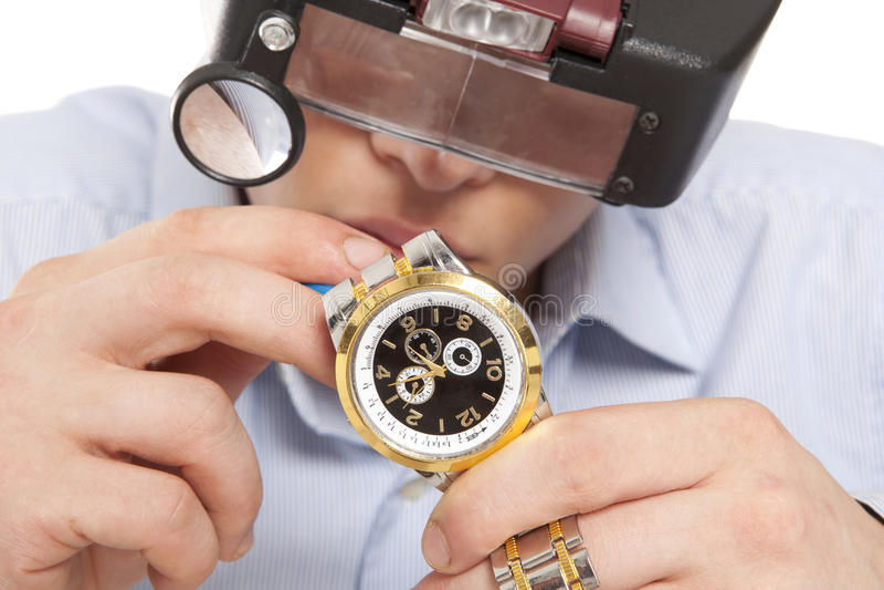 Watchmaker. Watch repair craftsman repairing watch royalty free stock images