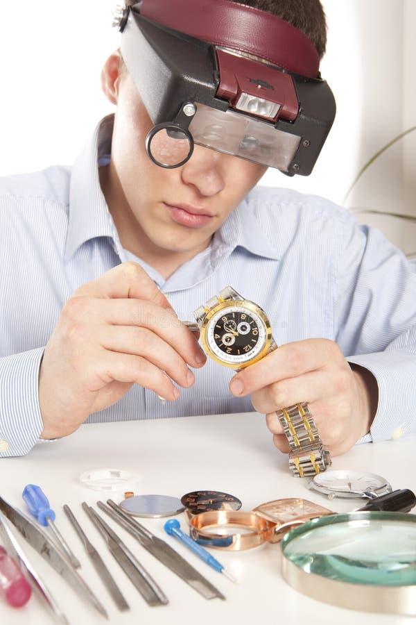 Watchmaker. Watch repair craftsman repairing watch royalty free stock photography
