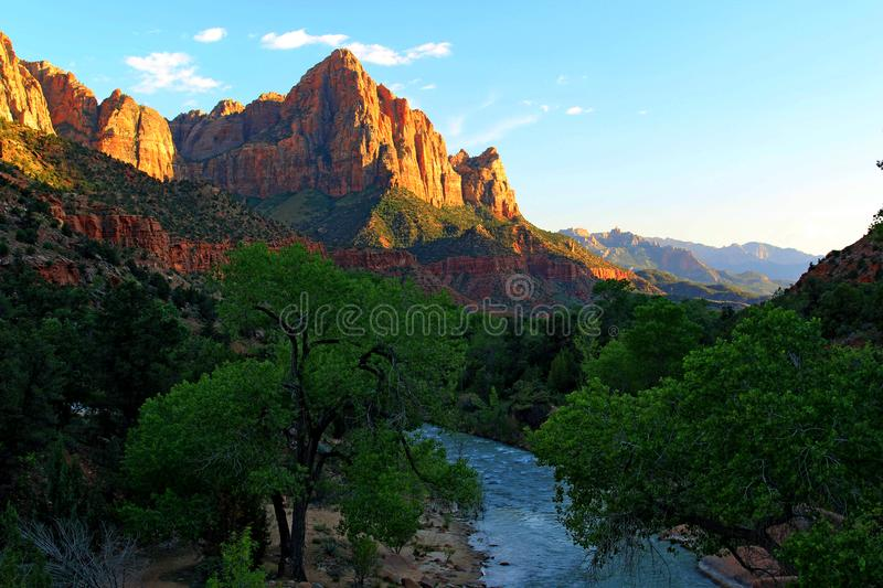 Watchman Towers over the Virgin River. The virgin river that runs thru Zion was unusually high due to flooding further up stream which prevented everybody from royalty free stock images