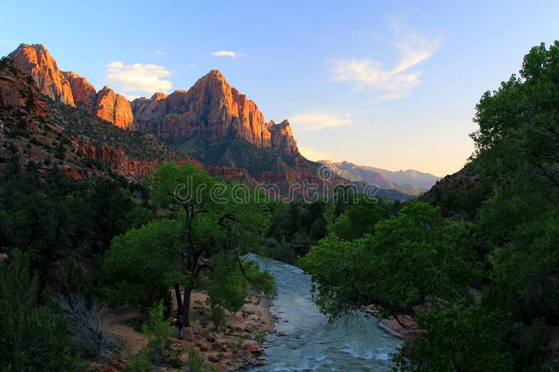Watchman Towers over the Virgin River. The virgin river that runs thru Zion was unusually high due to flooding further up stream which prevented everybody from royalty free stock image