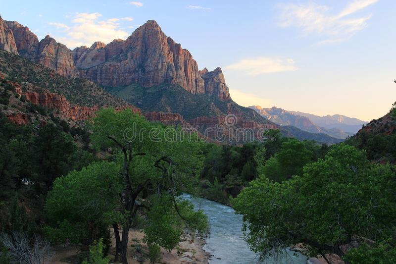 Watchman Towers over the Virgin River. The virgin river that runs thru Zion was unusually high due to flooding further up stream which prevented everybody from royalty free stock photo