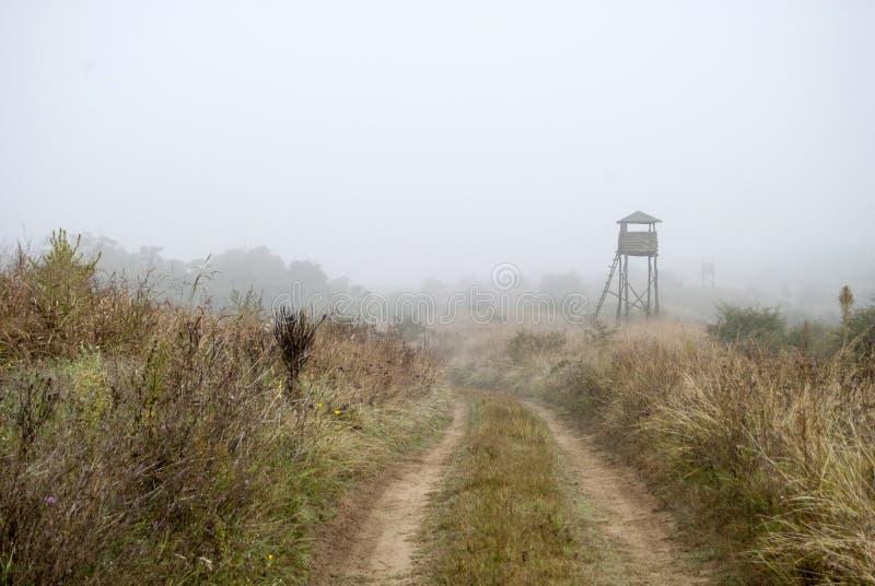 Watchtower in de mist stock afbeelding