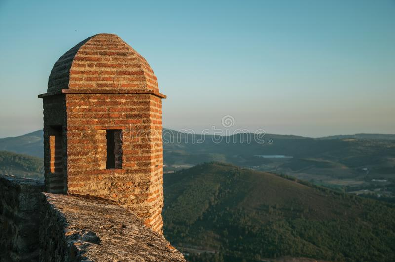 Watchtower made of bricks over cliff in Marvao royalty free stock images