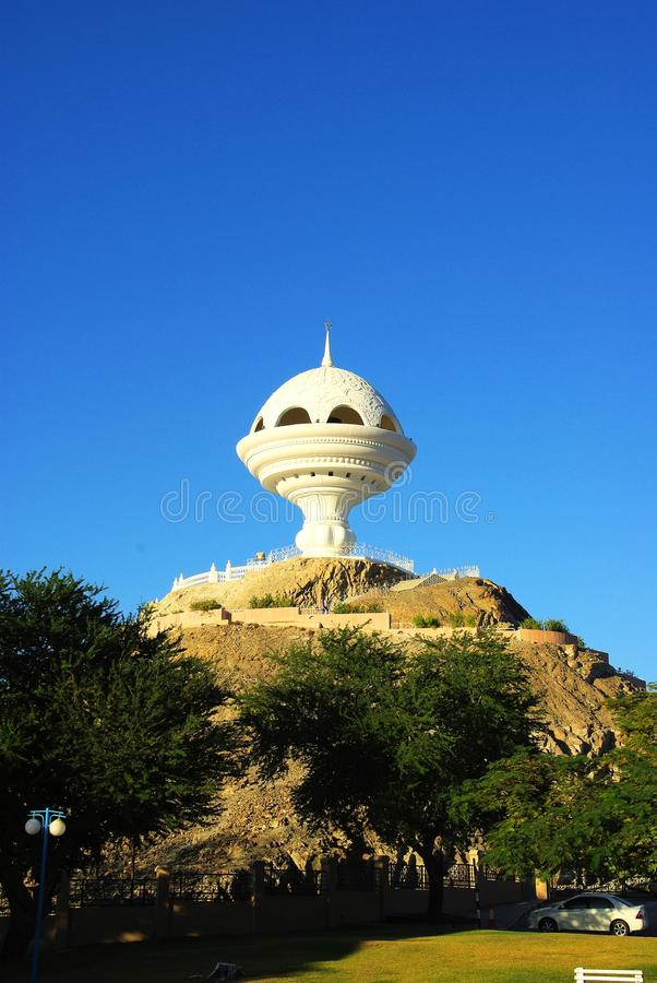 Watchtower in Muscat, Oman. A white modern watchtower built to look like an incense burner in Riyam Park Muscat, Oman. The tower draws tourists for the panoramic stock images