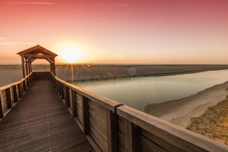 Watchtower At North Sea Dunes During Sunset stock image