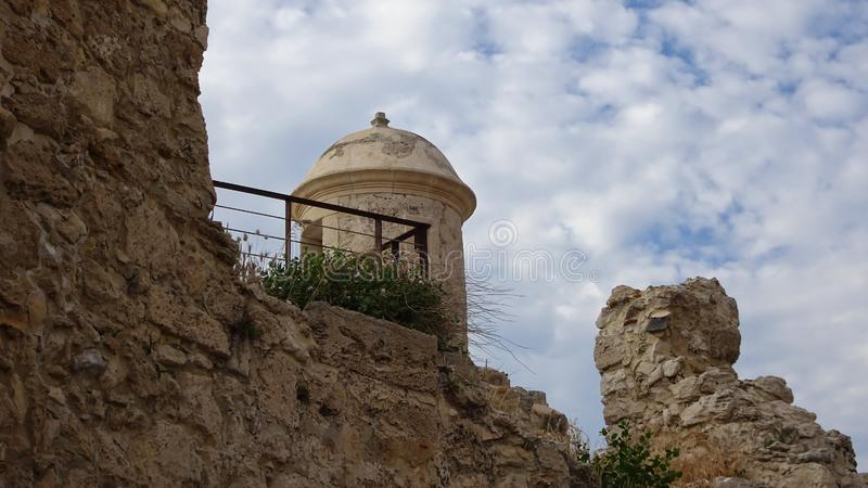 Watchtower with round dome on a stone wall royalty free stock photos