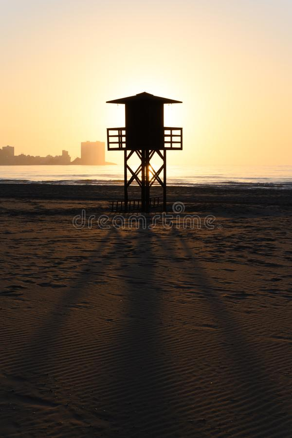Watchtower silhouette at the beach in Spain royalty free stock photos
