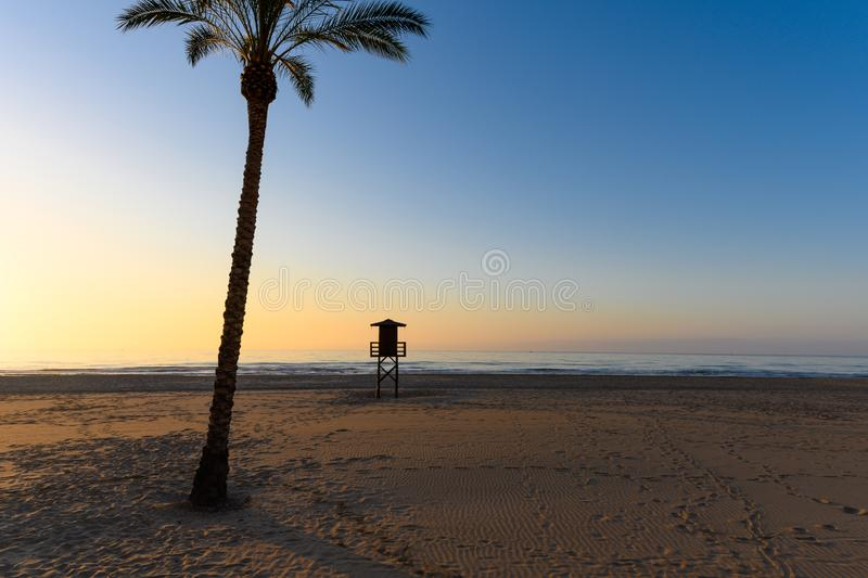 Watchtower silhouette at the beach in Spain stock photos