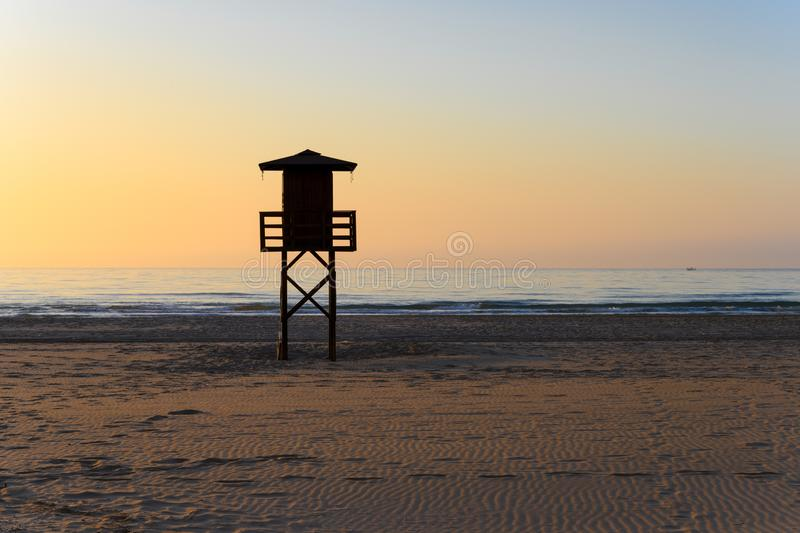 Watchtower silhouette at the beach in Spain stock images