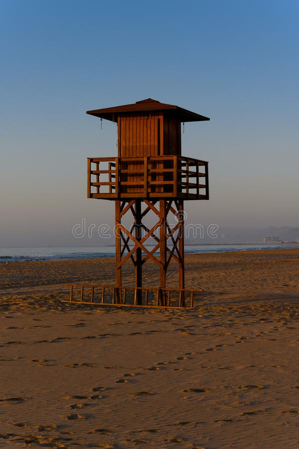 Watchtower silhouette at the beach in Spain royalty free stock images