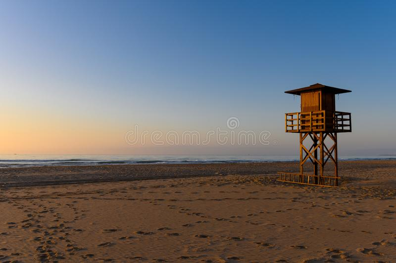 Watchtower silhouette at the beach stock images