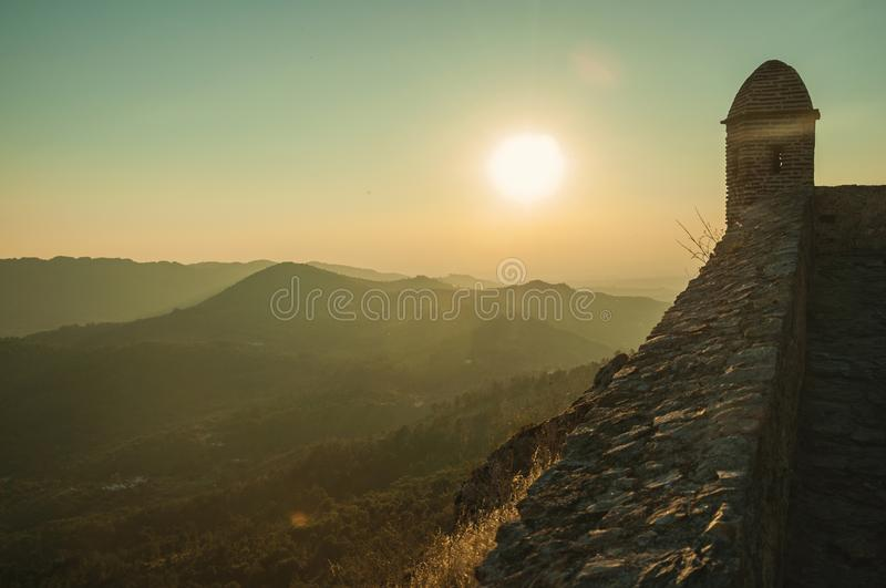 Watchtower and stone wall over rocky cliff in Marvao royalty free stock image