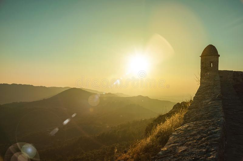 Watchtower and stone wall over rocky cliff in Marvao stock images
